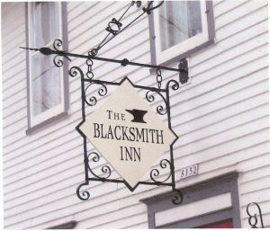 "Sign Bracket.  Mild steel.  Painted finish.  ""Blacksmith Inn B+B"", Baileys Harbor, WI."