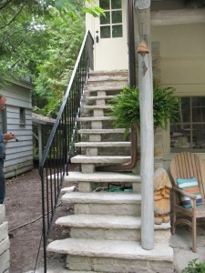 A simple railing on limestone steps.  Mild steel.  Private Residence, Egg Harbor, WI.