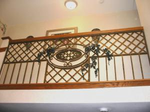 Grape Vine railing.  Mild steel, with Gilders Paste (TM) finish.