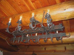 Chandelier and Pot rack.  Mild steel.  Gilders Paste (TM) finish.  Private residence, Elkhart Lake, WI.