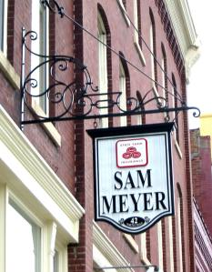 "Sign Bracket.  Mild steel.  Painted finish.  ""Sam Meyer Agency"", Fond du Lac, WI."