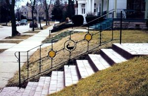 Railing. Mild steel and stained glass.  Painted finish.  Private Residence, Milwaukee, WI.