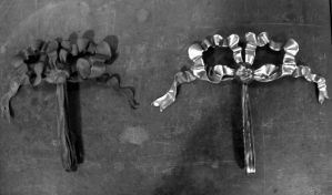 Original bow to the left, repro on right.